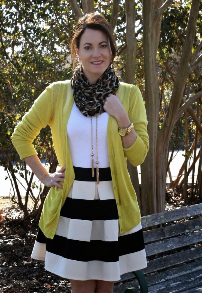 Tassel necklace, striped skirt