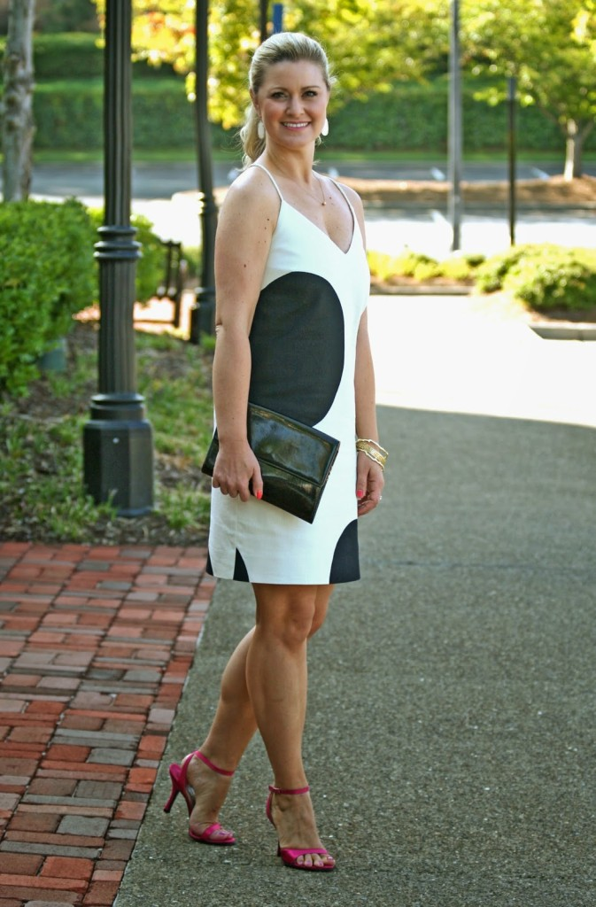 Black cocktail dress with pink shoes