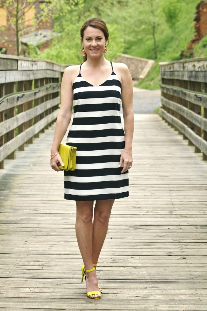 White dress with neon accessories for automobiles
