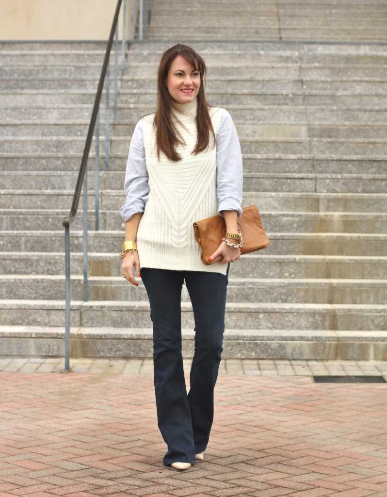 flare jean outfit idea. Pair witha layered sleeveless sweater and heels for the perfect early spring outfit.