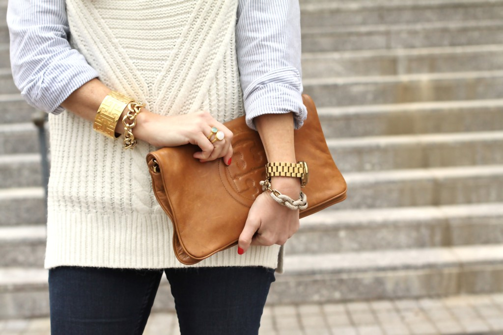 brown Tory Burch clutch with a layered sleeveless sweater via Peaches In A Pod blog.
