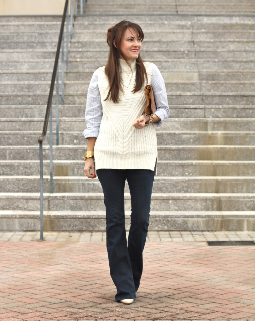 Transitioning into spring with a layered sleeveless sweater and flare jeans on Peaches In A Pod blog.