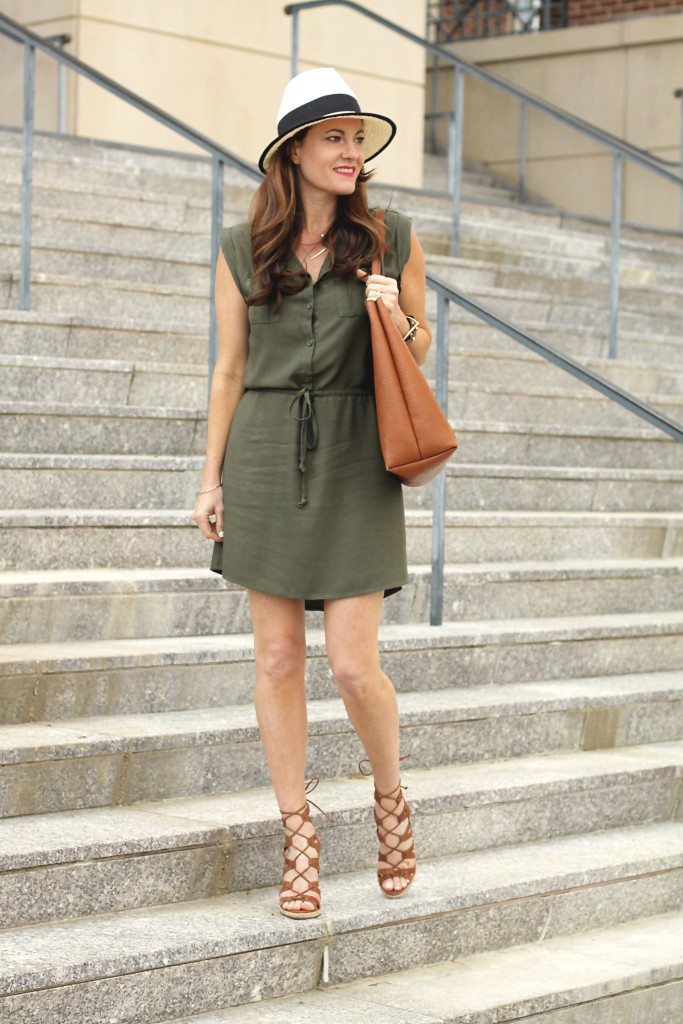 Shirt dress outfit idea for spring on Peaches In A Pod blog. Olive green shirt dress, panama hat, brown tote, and lace up wedges for the win.
