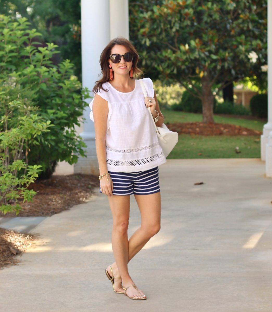 Cute Vacation Style via Peaches In A Pod Blog. Embroidered top, striped shorts, and backpack.