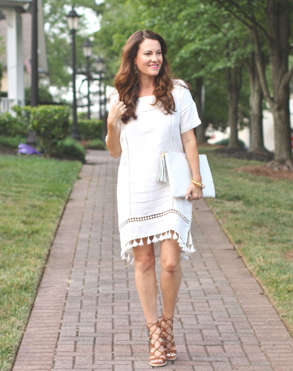 Cute tassel dress for the perfect summer date night look via Peaches In A Pod.