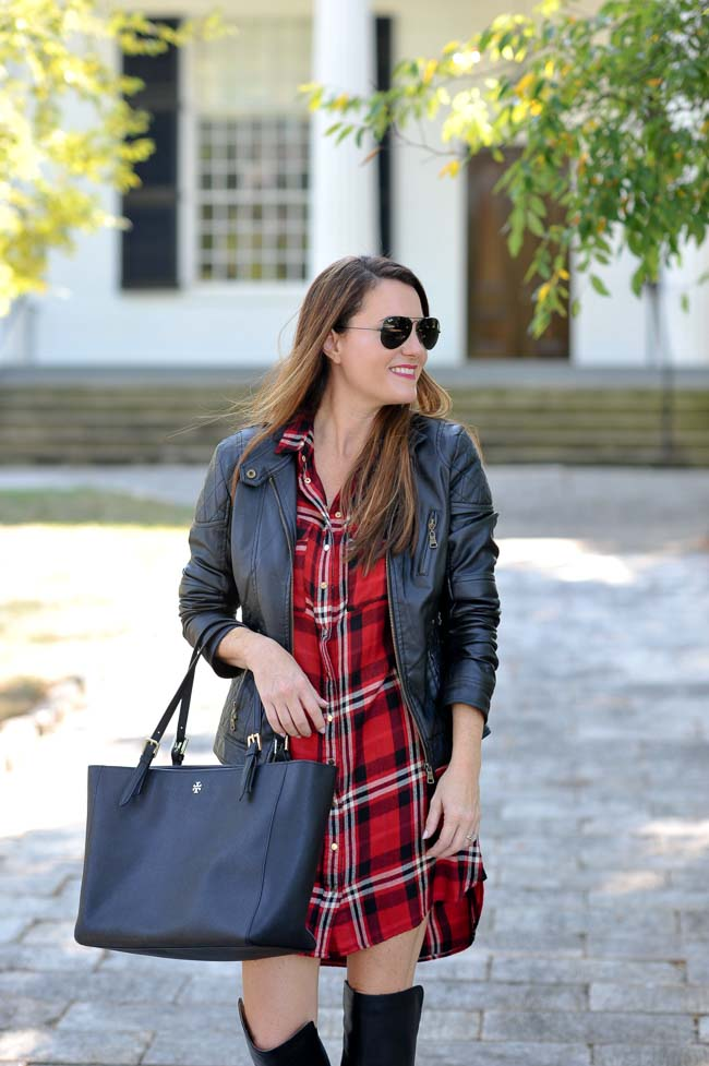 Black leather jacket styled with a plaid shirt dress via Peaches In A Pod blog.