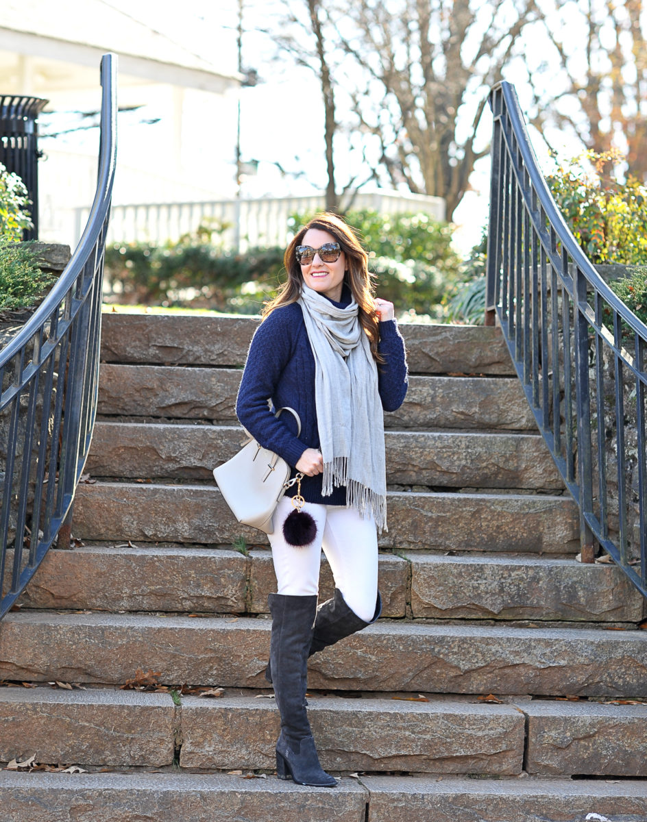 How to wear gray over the knee boots via Peaches In A Pod blog. Gray OTK boots, white denim, and navy sweater for the perfect winter outfit idea.