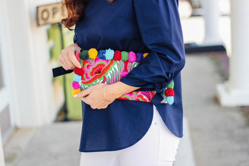 Embroidered pom pom clutch via Peaches In a Pod blog.