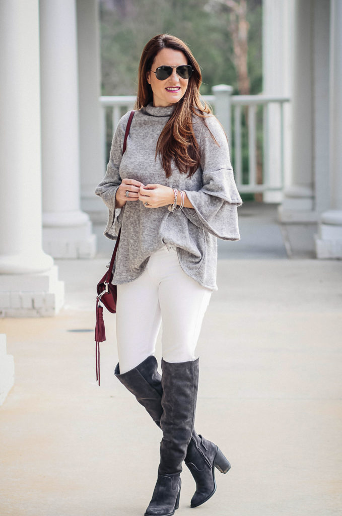 641066a7605 Gray boots outfit idea via Peaches In A Pod blog. Ruffle sleeve sweater  outfit for