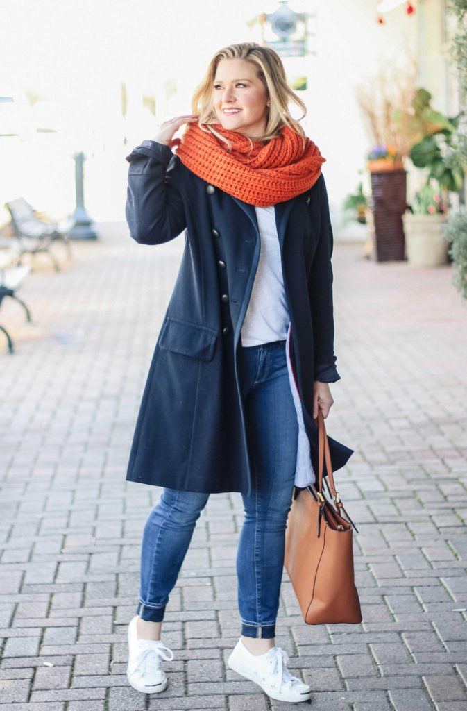 How to wear an oversized orange scarf in the wintertime without looking bulky.