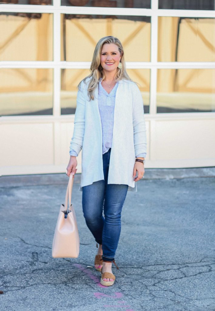 Cute casual outfit with a pink tote and striped top. Great to transition into spring.