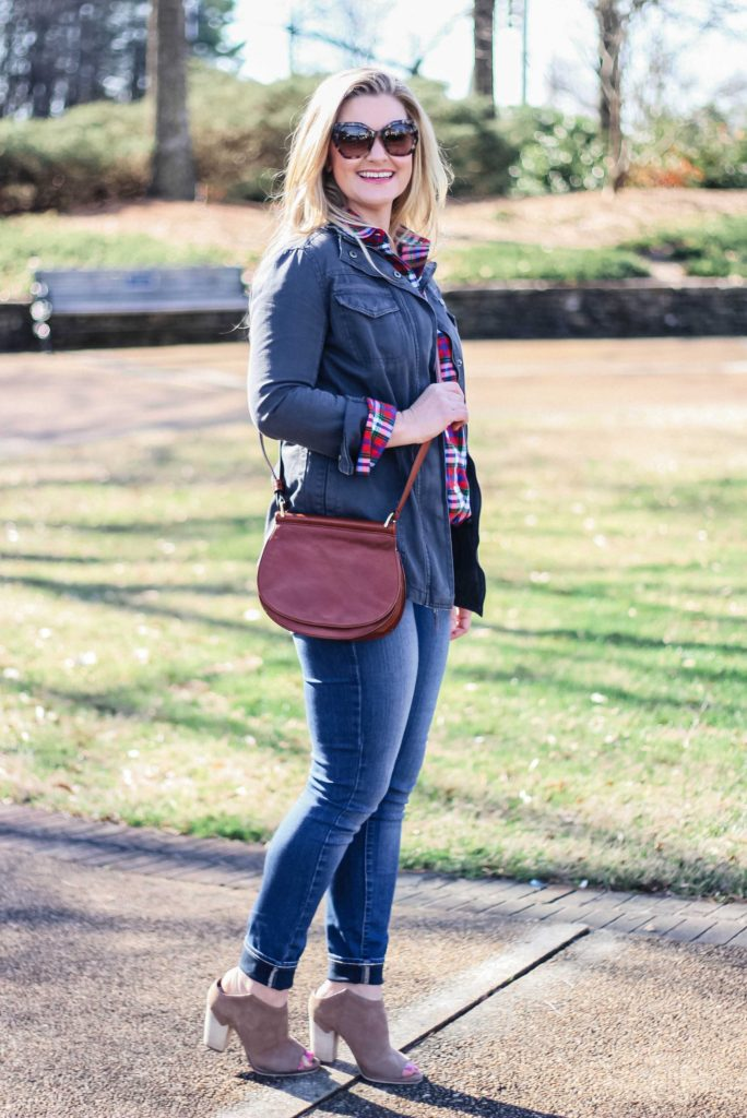 Cute casual Spring outfit with a plaid shirt and a utility jacket, paired with booties.