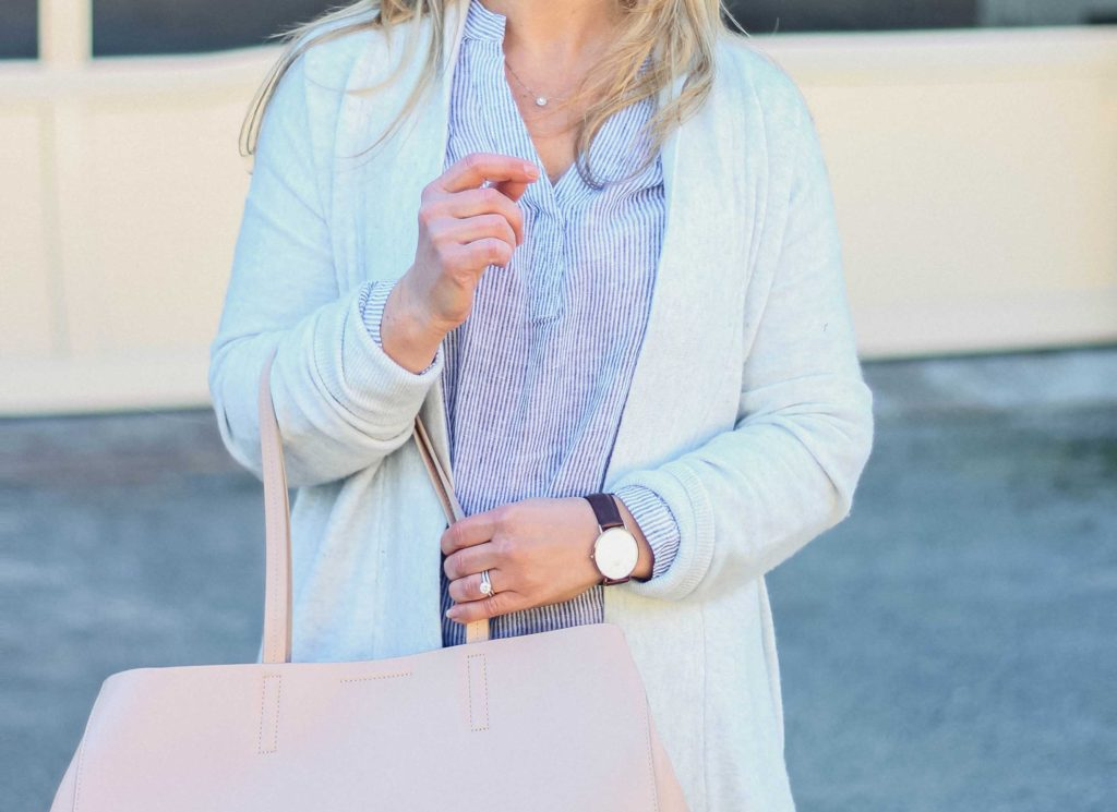 Cute striped blouse that is perfect for Spring. Paired with a gray cardigan and pink tote.