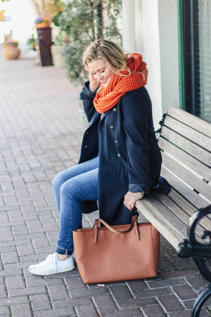Cute and casual winter outfit with an oversized scarf and navy wool coat.