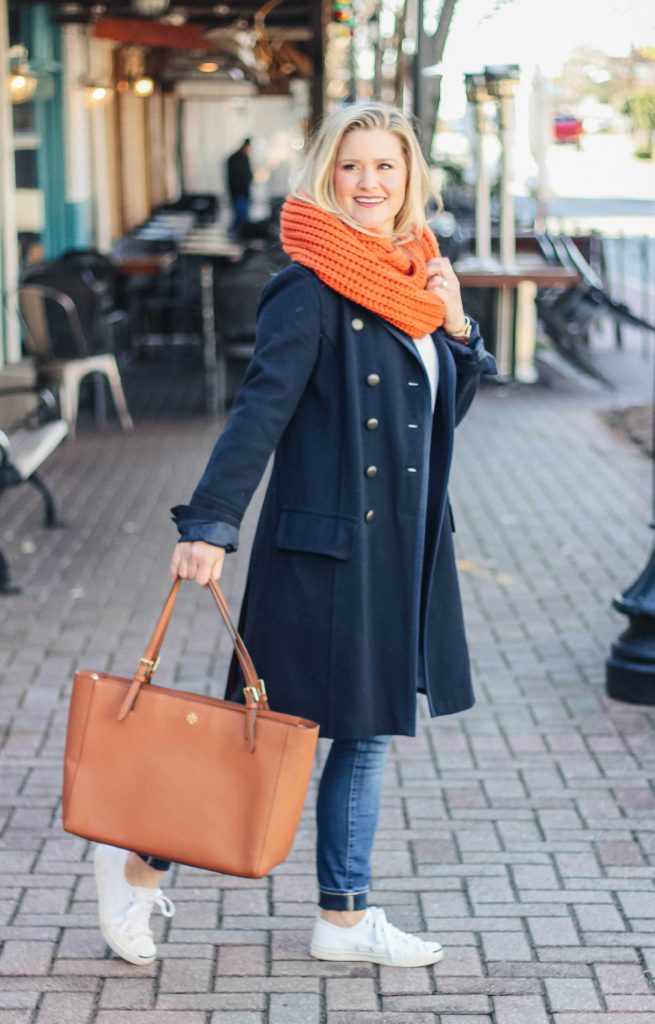 How to style a navy wool coat with an oversized scarf and sneakers to create a great casual outfit.