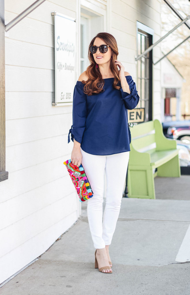 How to wear an off the shoulder blouse this spring via Peaches In A Pod blog. We love this classic off the shoulder blouse in navy.
