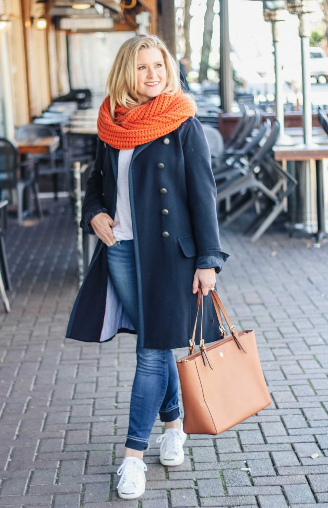 Cute winter casual outfit with an oversized scarf and sneakers.