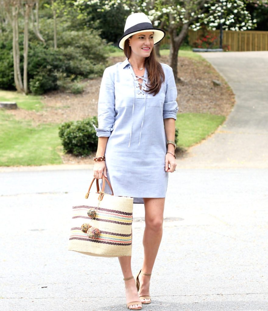 Best Spring outfit ideas for women via Peaches In A Pod blog. This lace up shirt dress is perfect for spring paired with a beach tote and sandals.