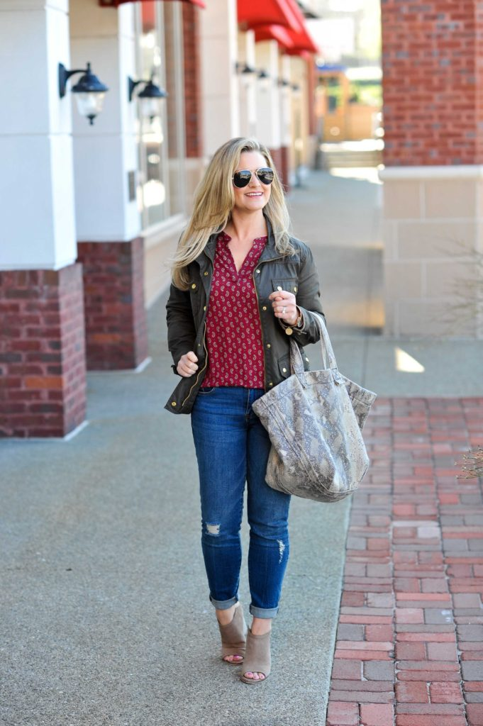 Cute red top outfit with a olive green jacket and distressed jeans. Perfect for the Spring transition.