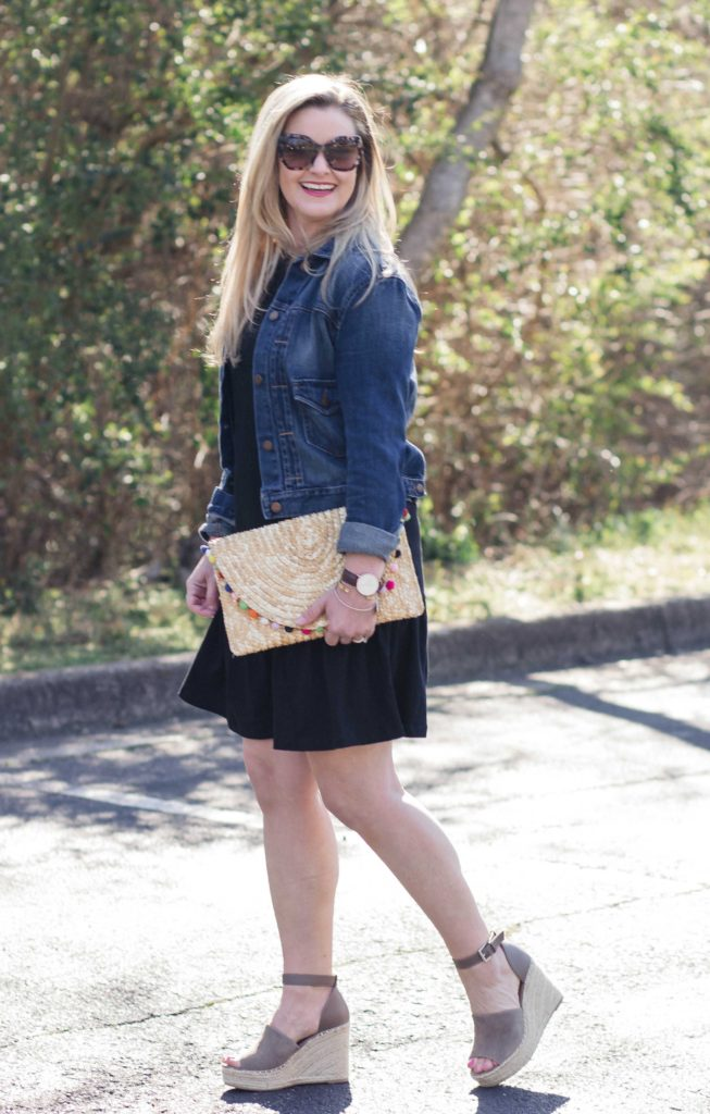 Cute ruffle hem black shirt dress paired with a denim jacket to create a great casual spring outfit.