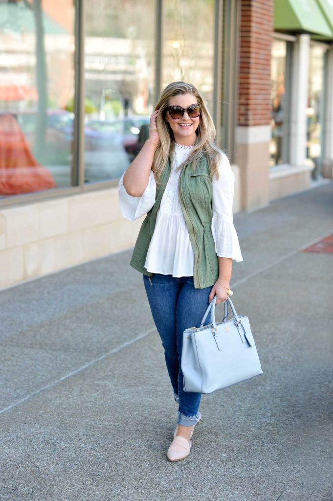 Cute Spring outfit with a white embroidered top and skinny jeans. The perfect casual outfit.