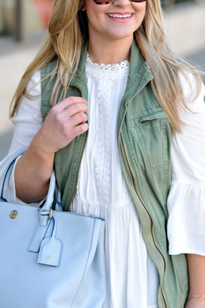 How to style a cute embroidered blouse that is the perfect top to wear into spring. Pair it with a cute military vest and mules to create a great casual look.