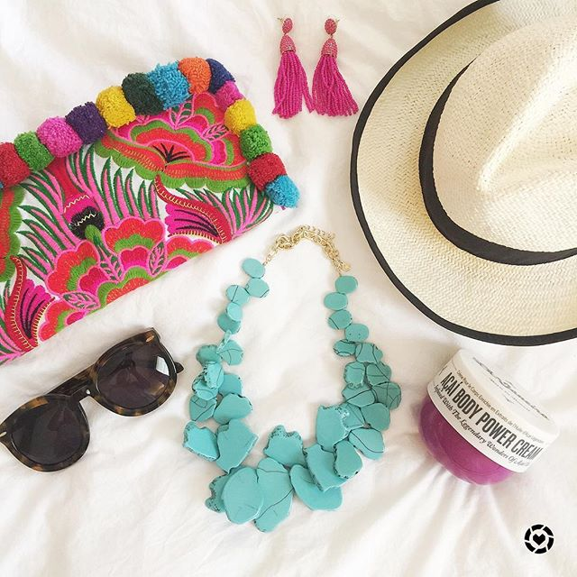 Cute spring break essentials with a pom pom clutch and a turquoise necklace