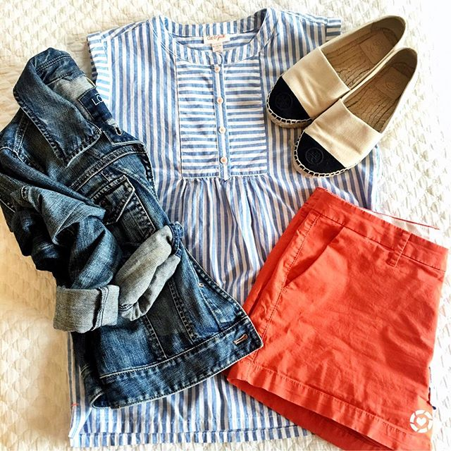 A great Spring outfit with bright orange shorts and a cute striped top. Paired with a denim jacket for the perfect look.