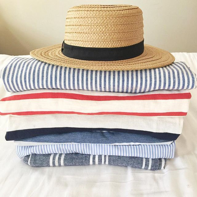 The perfect items to pack for a beach vacation. A straw hat is a must and the cutest striped pants.