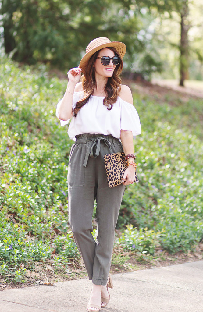 How to wear high rise paper bag pants via Peaches In A Pod blog. Cute spring outfit idea with these olive high rise pants, cold shoulder top and straw boater hat.