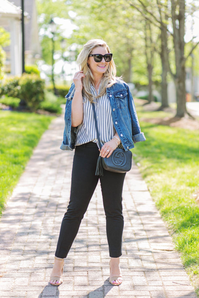 how to style a jean jacket with black pants and a striped shirt. Cute casual work outfit.