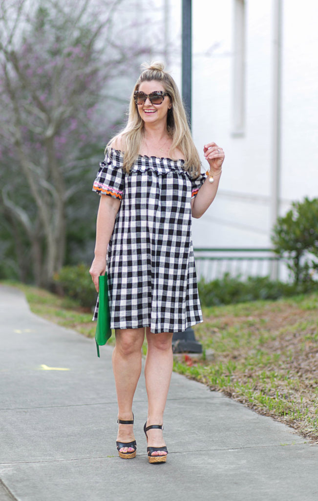 How to style a cute off the shoulder dress for the Springtime with platform wedges and a fun green clutch.