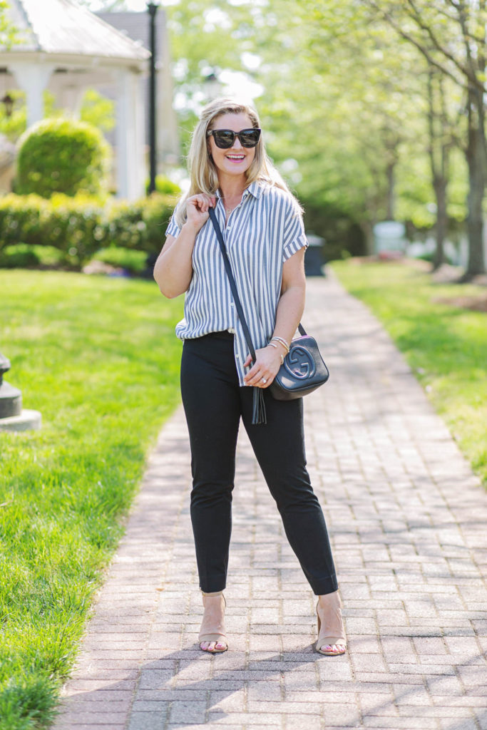 cute summer casual work outfit with black pants and a cute striped top.