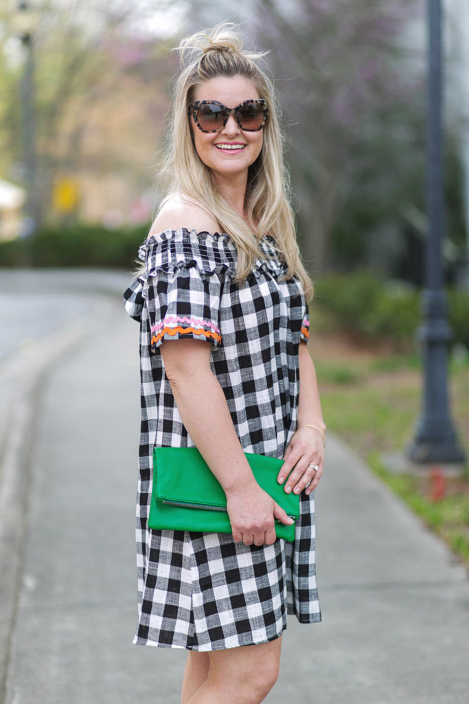 How to style an off the shoulder gingham dress with a fun clutch and the perfect sunglasses.