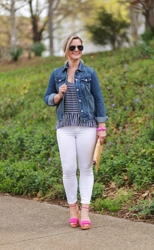 how to wear white jeans in the Spring with a denim jacket and a cute striped top.