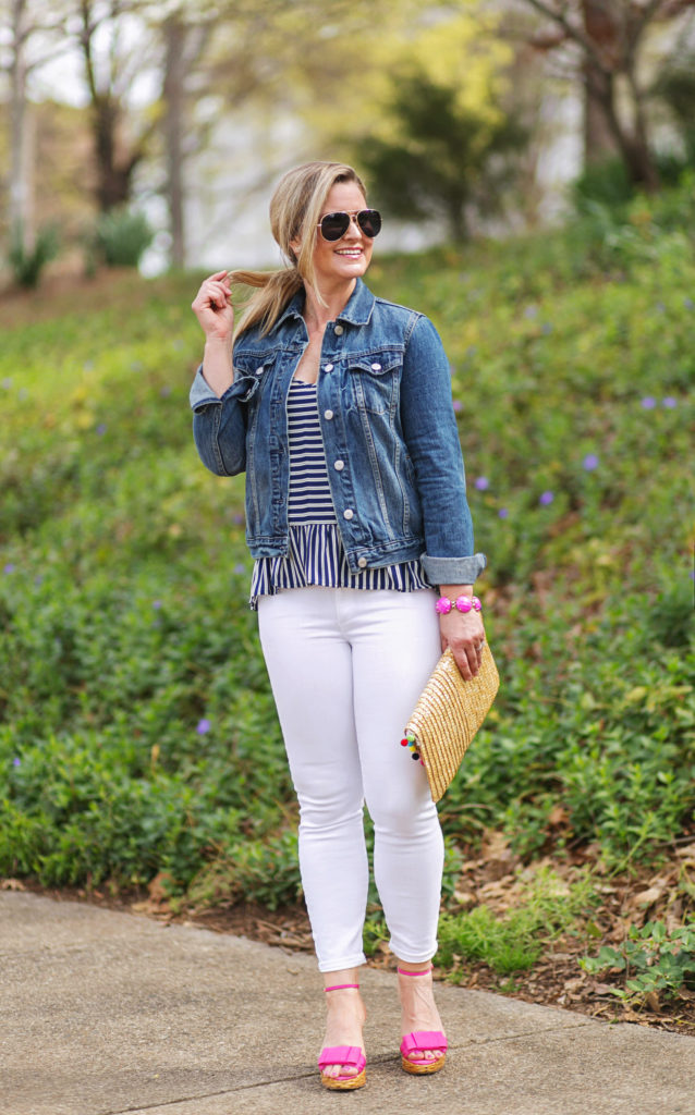 The perfect Spring outfit with white jeans and a denim jacket. Paired with a striped camisole to create a great casual look