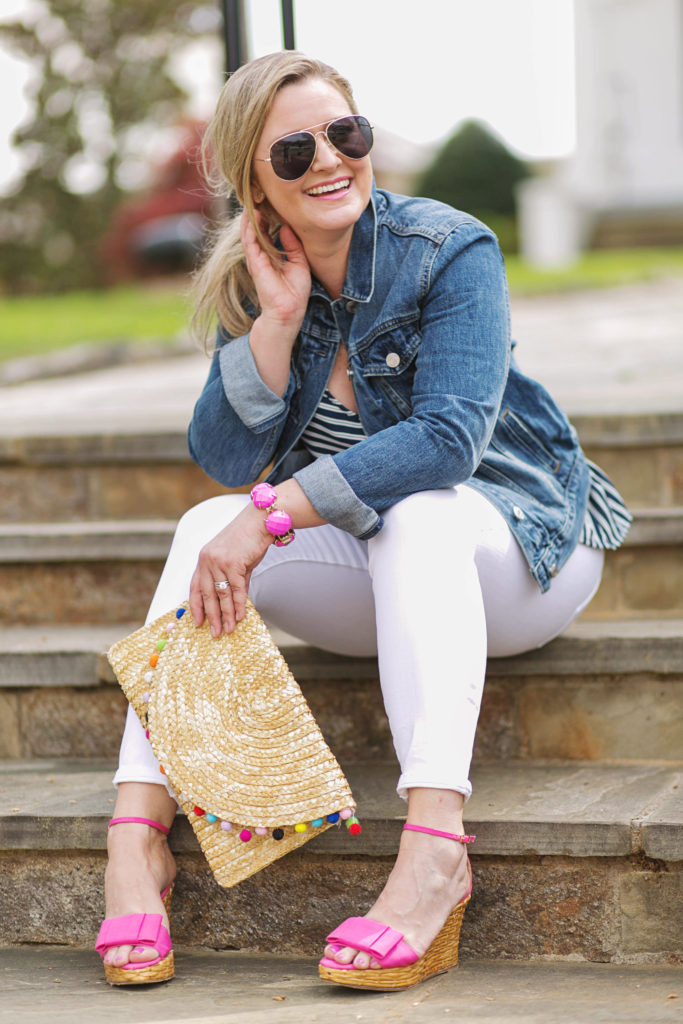 Cute Spring outfit with a pom pom clutch and pink wedges. Perfect for a casual afternoon outing.