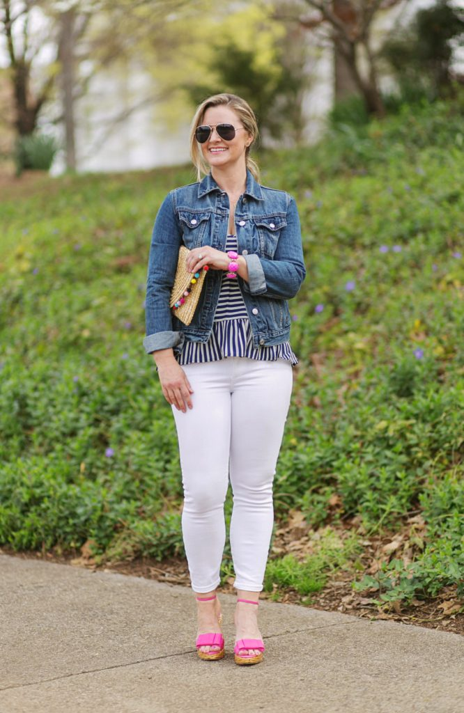 Cute casual spring outfit with white jeans and denim jacket. Paired with pink wedges for a great pop of color.