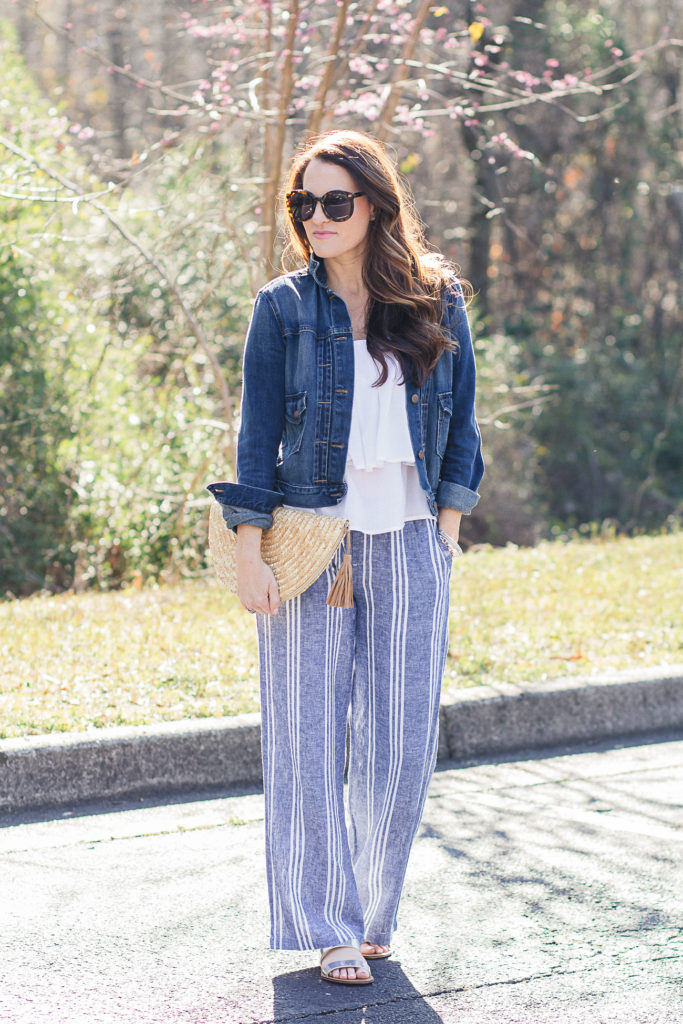 How to wear wide leg pants via Peaches In A Pod blog. Striped wide leg linen pants, cute straw clutch, denim jacket and sandals.