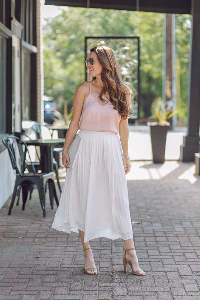 How to wear a pleated skirt via Peaches In A Pod blog. The ultimate feminine look for summer. Pleated skirt and pink cami outfit.
