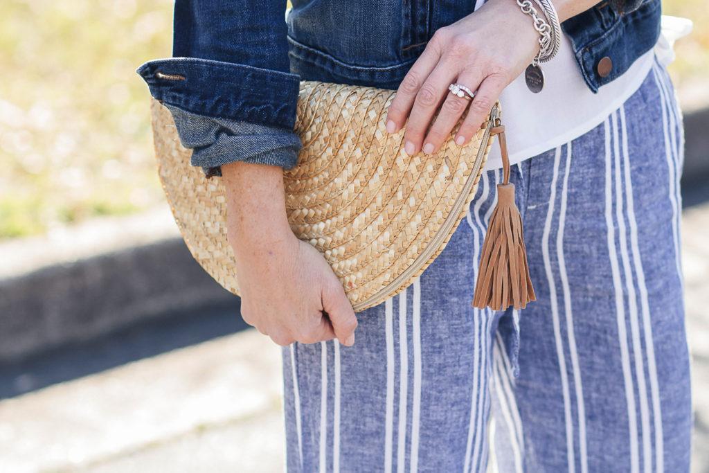 Cute tassel straw clutch via Peaches In A Pod blog.