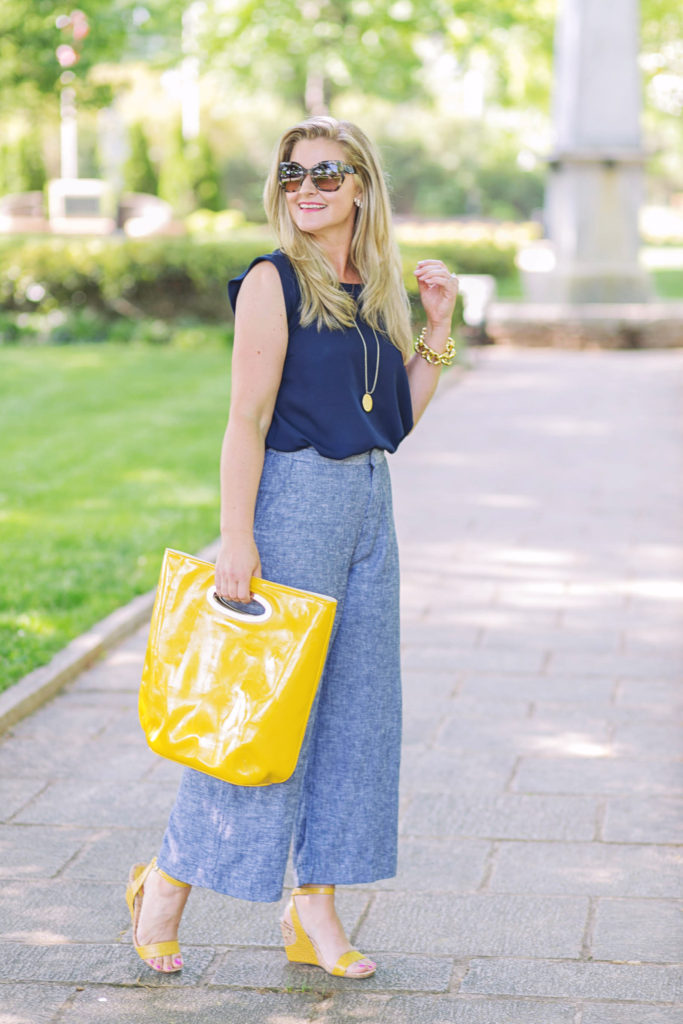 Cute high waisted cropped wide leg pants paired with yellow wedges to create a great summer outfit.