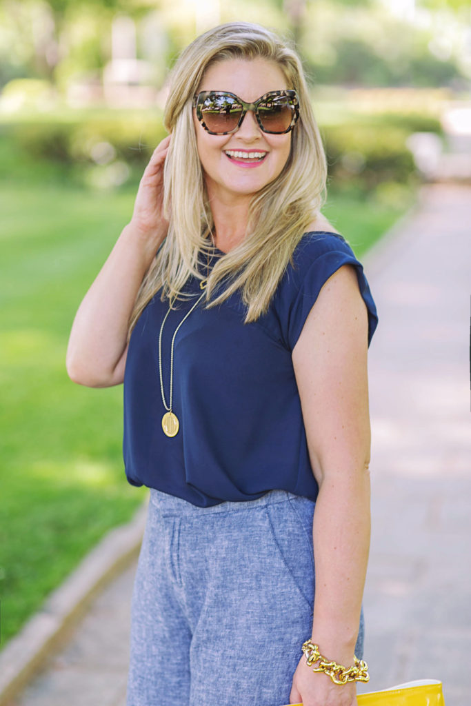 How to dress up a navy blue top to create the perfect summer work outfit.
