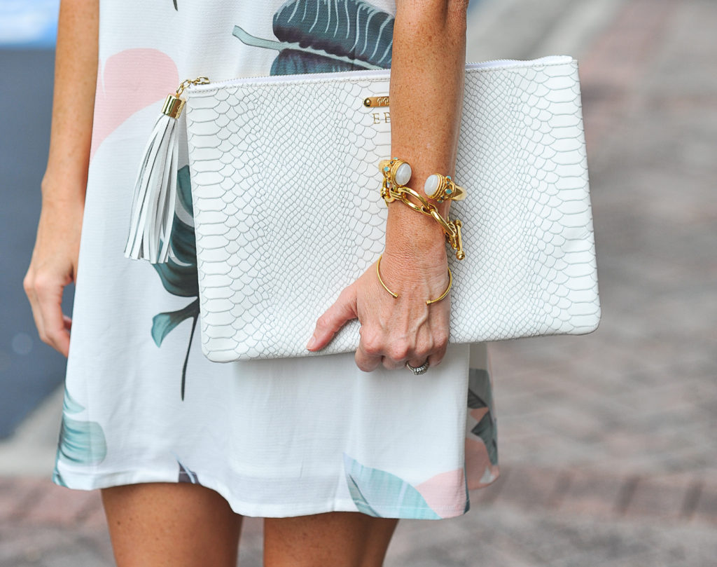 Gigi New York white Uber clutch via Peaches In A Pod blog.