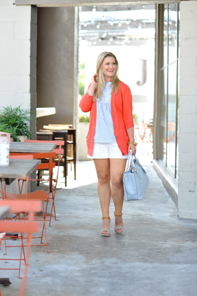 cute summer outfit with white shorts and a coral sweater. The perfect outfit for cool nights or casual afternoon outings.