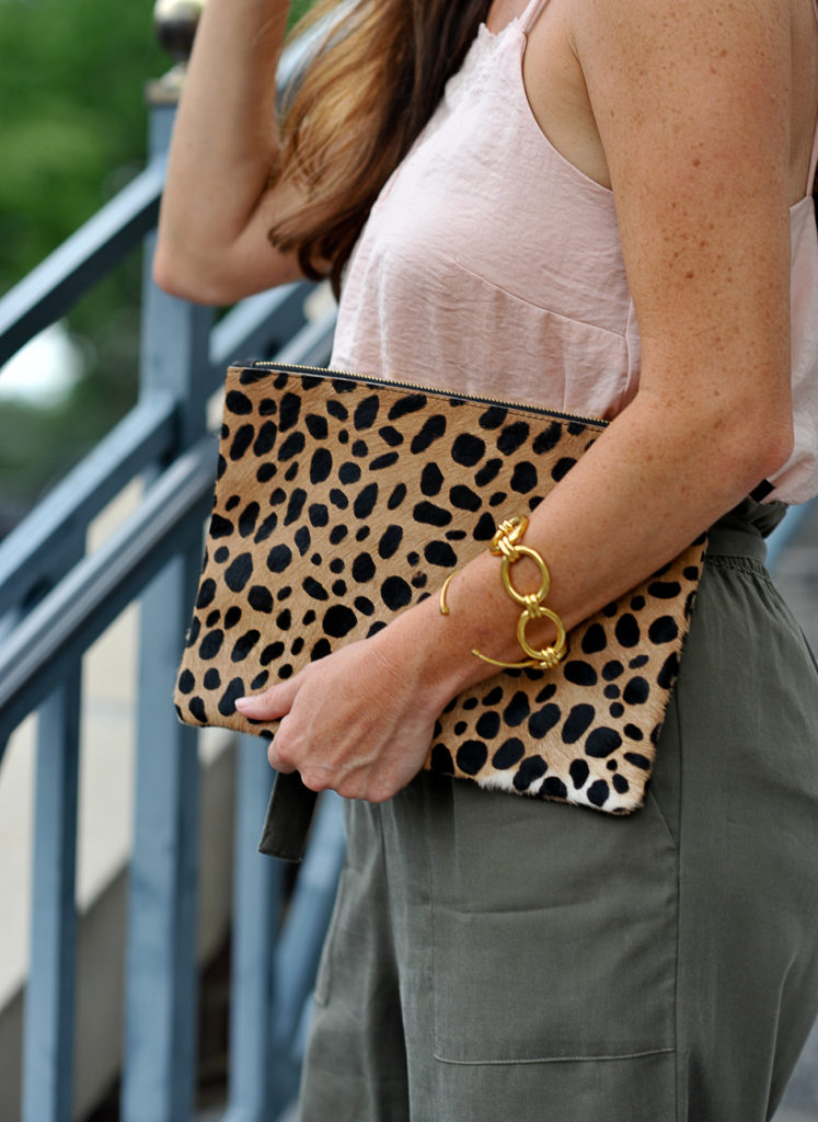 Our favorite calf hair leopard clutch via Peaches In A Pod blog.