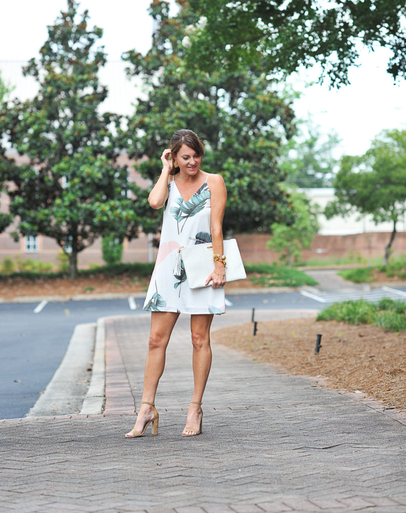 Dressy Summer outfit idea via Peaches In A Pod blog. This pretty palm print dress is perfect for a summer date night.