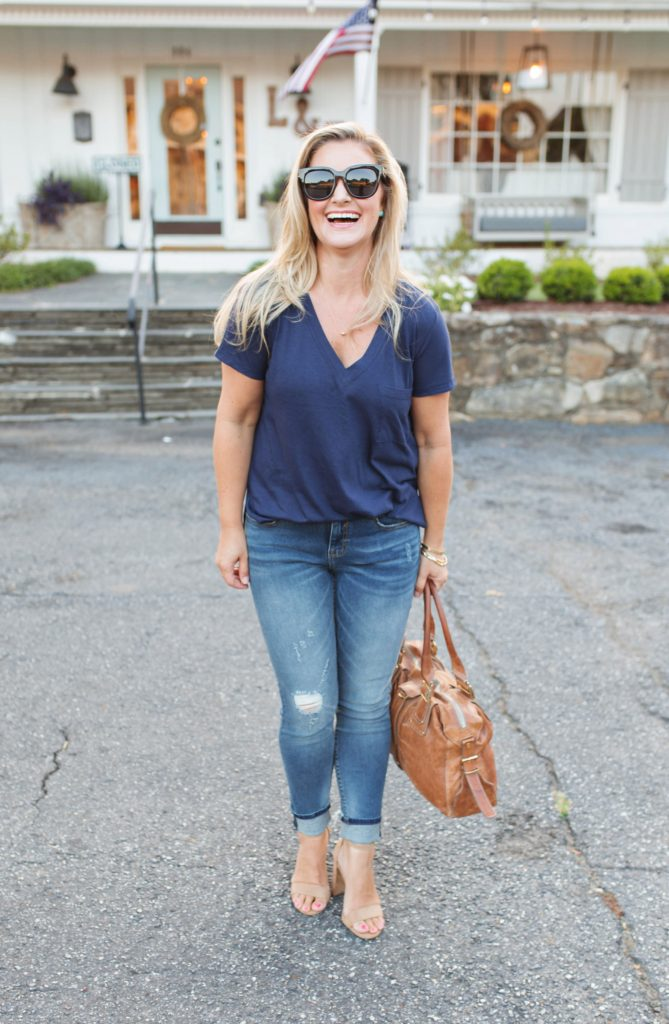 how to dress up a t-shirt with nude heels and distressed jeans to create an effortless evening look.