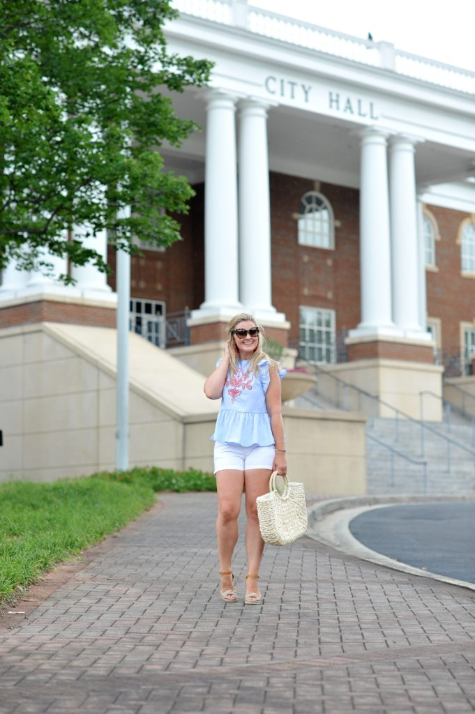 The perfect summer outfit with a striped peplum top and a straw bag.