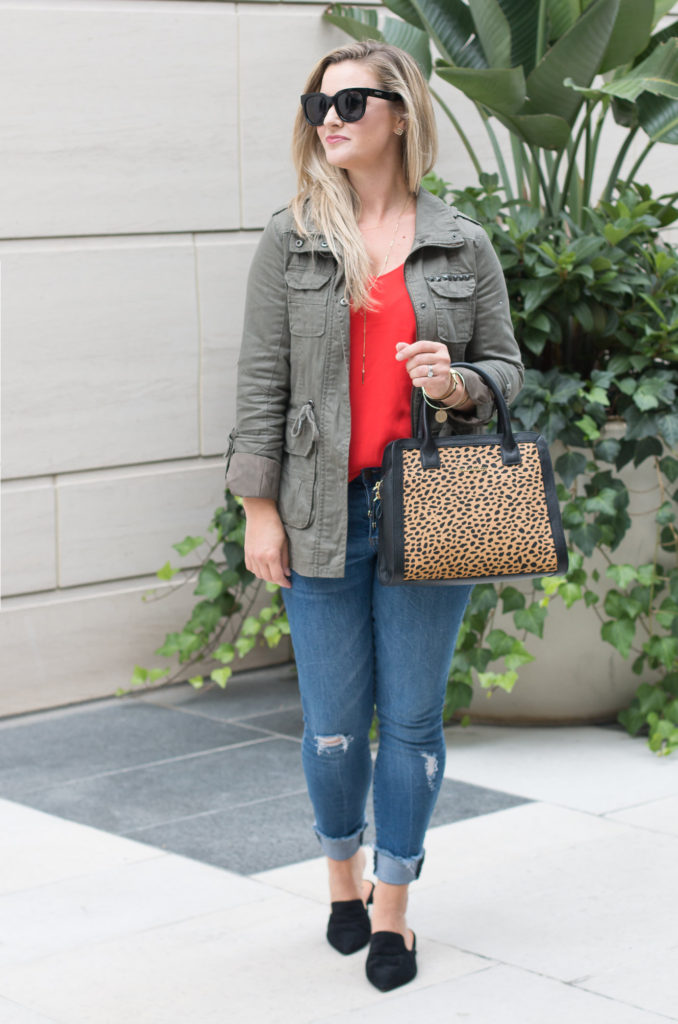 Cute fall outfit with distressed jeans and a tomato red cami.